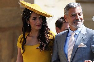 Amal and George Clooney will be in Edinburgh today. Pic: PA