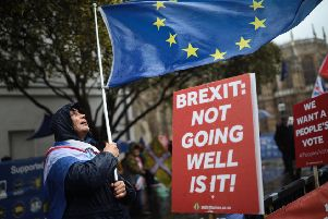 LONDON, ENGLAND - MARCH 12:  Anti Brexit demonstrators protest in the rain ahead of the meaningful vote in Parliament on March 12, 2019 in London, England. MPs, who rejected Theresa May's Brexit deal earlier this year by a majority of 230, are due to vote on revised proposals after Theresa May secured last-minute legally binding changes, wanted to ensure the UK couldnt be indefinitely tied to the Irish backstop and a permanent customs union. (Photo by Dan Kitwood/Getty Images)