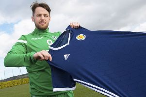 Marc McNulty weighs up a Scotland jersey, which he could be wearing in the forthcoming matches against Kazakhstan and San Marino. Picture: SNS.