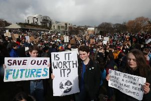 Students take part in a global school strike for climate change outside the Scottish Parliament building in Edinburgh, as protests are planned in 100 towns and cities in the UK. Pic: Jane Barlow/PA Wire
