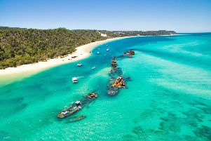 A number of sunken ships at Moreton Island off the coast of Brisbane in Queensland, Australia. These shipwrecks are located just north of Tangalooma Island Resort.