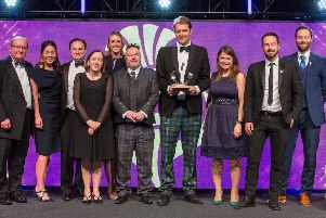 Rory Colville, tournament director of the Aberdeen Standard Invesments Scottish Open, receives the award along with other members of the team involved in the event