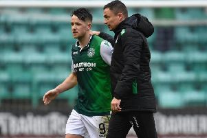 Paul Heckingbottom congratulates Marc McNulty at the end of Hibs v Motherwell. Pic: SNS