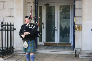A piper plays the Bagpipes outside Scotland Office Dover House in Whitehall. Pic: Amer Ghazzal/REX/Shutterstock