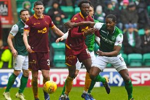 Hibs' Marvin Bartley competes with Gboly Ariyibi during the 2-0 win over Motherwell. Pic: SNS