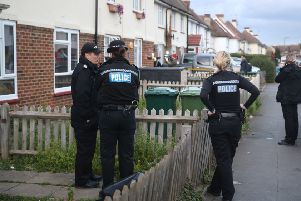 Police in Viola Avenue in Surrey where they are investigating a stabbing in which a man rampaged with a baseball bat and knife while hurling racist abuse. Picture: Steve Parsons/PA Wire