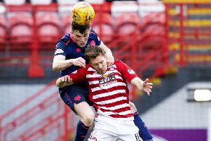 Hearts' John Souttar outjumps David McMillan of Hamilton for a header. Picture: SNS.