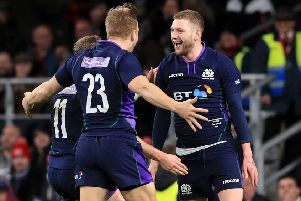 Man of  the match Finn Russell celebrates with replacement Chris Harris after scoring Scotland's equalising try. Picture: PA.