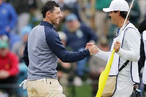 Rory McIlroy celebrates with his caddie Harry Diamond after holing the winning putt in the Players Championship at Sawgrass. Picture: Getty