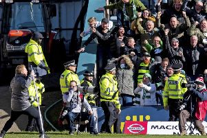 Neil Lennon (lower left) raced up the touchline to celebrate with the travelling fans. Picture: SNS Group