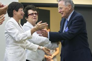 Birch Bay is applauded by Senior Adviser to the President and Chair of the Council on Women and Girls Valerie Jarrett, and tennis great Billie Jean King in 2012. Picture: AP