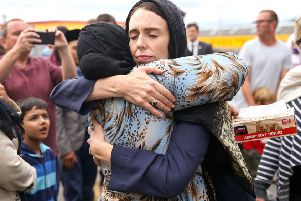 Prime Minister Jacinda Ardern hugs a worshipper at the Kilbirnie Mosque in Wellington, New Zealand. Picture: Getty