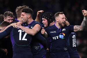 Scotland players celebrate after scoring a try against England at Twickenham
