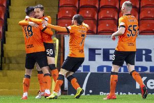 Calum Butcher, left, celebrates with team-mates after putting Dundee United ahead in the seventh minute. Picture: SNS