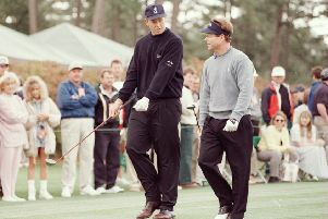 Gordon Sherry, left, chats to Tom Watson during a practice round ahead of the 1996 Masters. Picture: Stephen Munday/Allsport