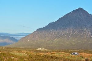 Campers in the shadow of Buachaille Etive Mor, at the entrance to Glen Etive.