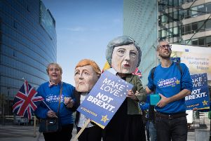 Anti-Brexit protesters dressed as Theresa May and Angela Merkel outside the EU Commission in Brussels today. Picture: PA