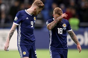 Striker Oli McBurnie, left, was an isolated figure up front and was eventually replaced by Johnny Russell, right. Picture: Adam Davy/PA Wire