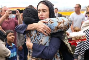 Jacinda Ardern hugs a mosque-goer at the Kilbirnie Mosque in Wellington after the worst mass shooting in New Zealand's history (Picture: Hagen Hopkins/Getty)