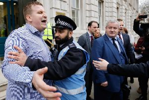 Police restrain a man who was shouting pro-Brexit slogans at Scottish National Party (SNP) MP and Westminster leader Ian Blackford (R) outside the Cabinet Office. Picture: Getty Images