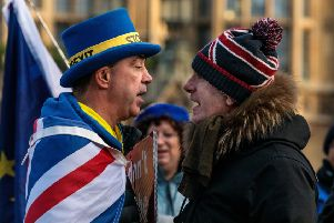 Anti-Brexit protester and a pro-Brexit protester argue. (Photo by Jack Taylor/Getty Images)