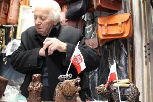 The 92 year old surrounded by leather bags in his Leather Goods shop on Lauriston Street, where he still works. Picture: Megan Merino