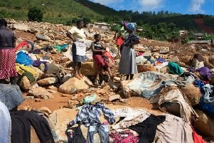 Women dry clothes recovered from rubble on March 19, 2019 in the Ngangu township of Chimanimani, after the area was hit by the Cyclone Idai. Picture: AFP/Getty Images