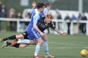 Edinburgh City forward Scott Shepherd is sandwiched between Peterhead's Patrick Boyle and Jason Brown. Pic: Neil Hanna