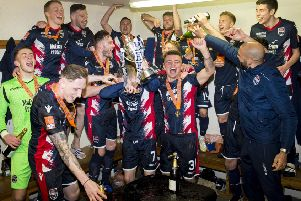 Ross County players enjoy their triumph in the dressing room following their Irn-Bru Cup final victory over Connah's Quay Nomads. Picture: SNS.