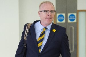 Alex McLeish arrives back at Glasgow Airport after Scotland's trip to Kazakhstan and San Marino. Picture: SNS Group