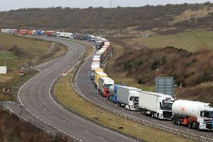 Lorries queue at the entrance to the Port of Dover in Kent. Picture: Gareth Fuller/PA Wire