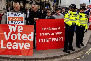 Pro-Brexit activists hold placards as they demonstrate outside the Houses of Parliament in central London. Picture: Niklas Halle'n/AFP