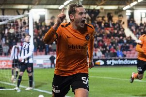 Dundee United goalscorer Peter Pawlett tangles with Dunfermline goalkeeper Ryan Scully at East End Park. Picture: SNs.