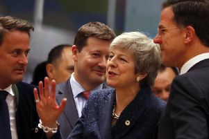 Prime Minister Theresa May speaks with other EU leaders. (AP Photo/Frank Augstein)