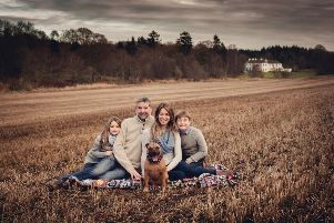 Tim and Stef Erbe with children Alex and Amy and their dog, Ginger, at the Logie Country House estate. Picture: Susan Ren�e at Kingshill Studios