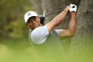 Tiger Woods plays his shot from the eighth tee in his match against Patrick Cantlay. Picture: Ezra Shaw/Getty Images