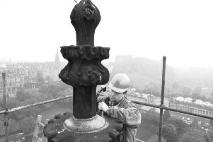Stone mason Jimmy Gilfillan works on the restoration of the stonework at the very top of the Scott Monument in Edinburgh, October 1988.