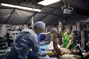A British surgeon works to help an Afghan casualty. Picture: Getty