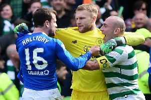 Andy Halliday, left, confronts Celtic captain Scott Brown, right, as Scott Bain intervenes. Picture: Getty