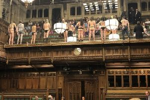 More than 10 people in the public gallery with messages written on their bodies joined the protest. Picture: PA
