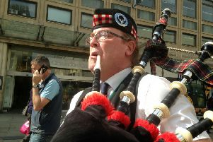 Busking bagpiper George Sinclair, 49, who is dividing opinion over his performances
