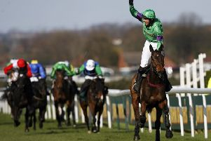 Jockey Liam Treadwell stands up in his irons to celebrate Mon Mome's 2009 Grand National victory. Picture: Paul Ellis/AFP/Getty
