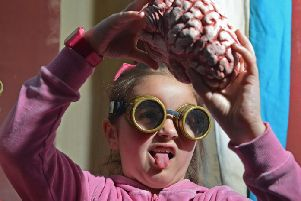A seven-year-old girl examines a life like human brain at the Edinburgh Science Festival. Pic: Jon Savage