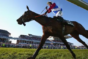 Jockey Derek Fox celebrates as he and One For Arthur cross the line to win the 2017 Randox Health Grand National'at Aintree. Picture: Alex Livesey/Getty