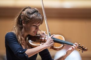 Scottish violinist Nicola Benedetti enjoyed a close and intimate rapport with the orchestra.. Picture: John Devlin