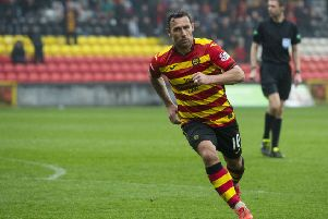 Partick Thistle's Scott McDonald celebrates his goal to makee it 2-2. Pic: SNS/Sammy Turner