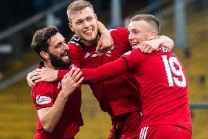 Sam Cosgrove, centre, celebrates his second goal with Aberdeen captain Graeme Shinnie and Lewis Ferguson. Picture: Ross Parker/SNS