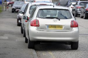Parking on pavements will be permitted in certain circumstances under the proposed new law (Picture: Neil Hannah)