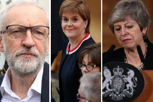 Theresa May (right) and Jeremy Corbyn get the lowest personal ratings in Scotland. Nicola Sturgeon's (centre) SNP score well againast both the Conservatives and Labour