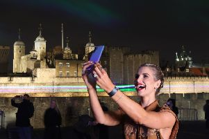TV's Vogue Williams launches the latest Huawei phone at the London Lights installation last week. Picture: Getty